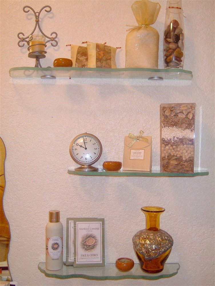 Bathroom shelves, glass with chiseled irregular edges, installed over commode.