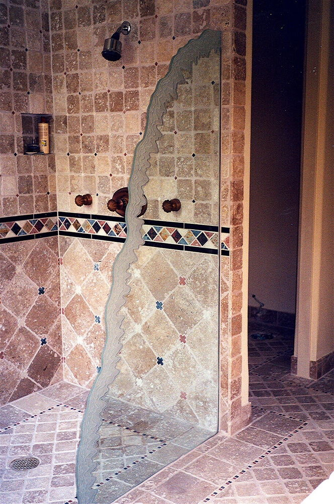"Freestanding glass shower divider panel, etched carved ""Shoreline Waves"" custom edge."