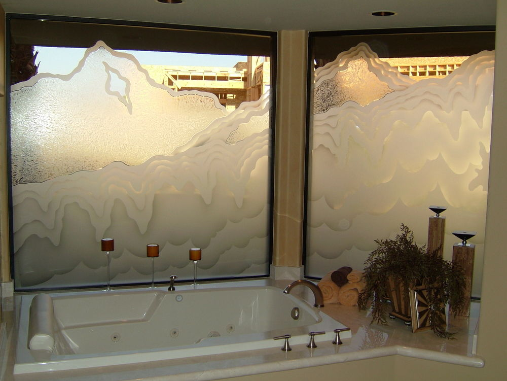 Decorative glass window, etched for privacy for tub & shower area.